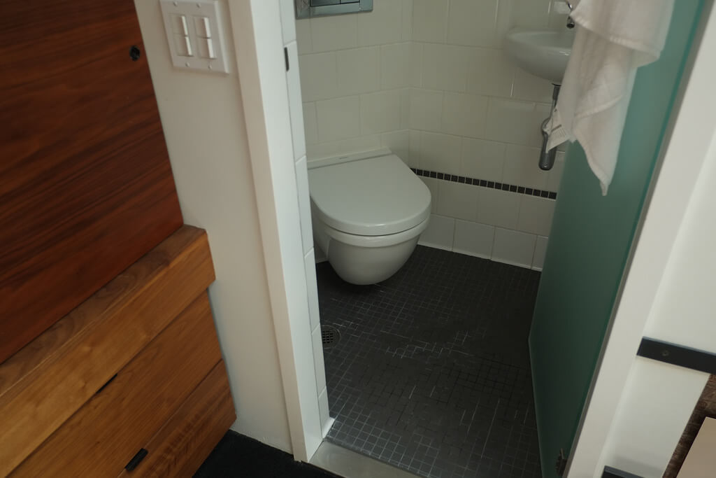 Closet and Full bathroom Euro-style shower with drain in the floor after Shower Drain Unclogging
