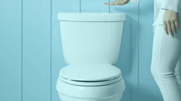 using a touchless toilet system by waving above the toilet