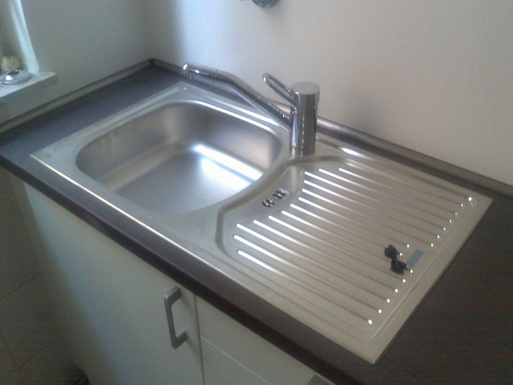 Plumbing problems: Small single kitchen sink with drain board.