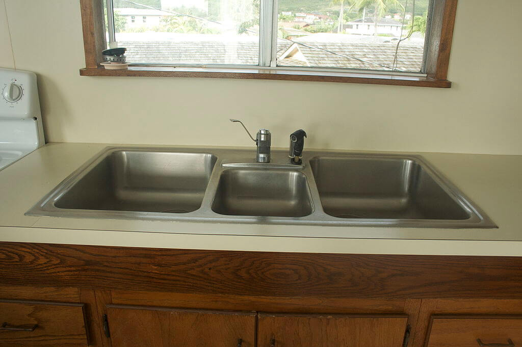 Plumbing problems: Triple basin kitchen sink with dish sprayer.