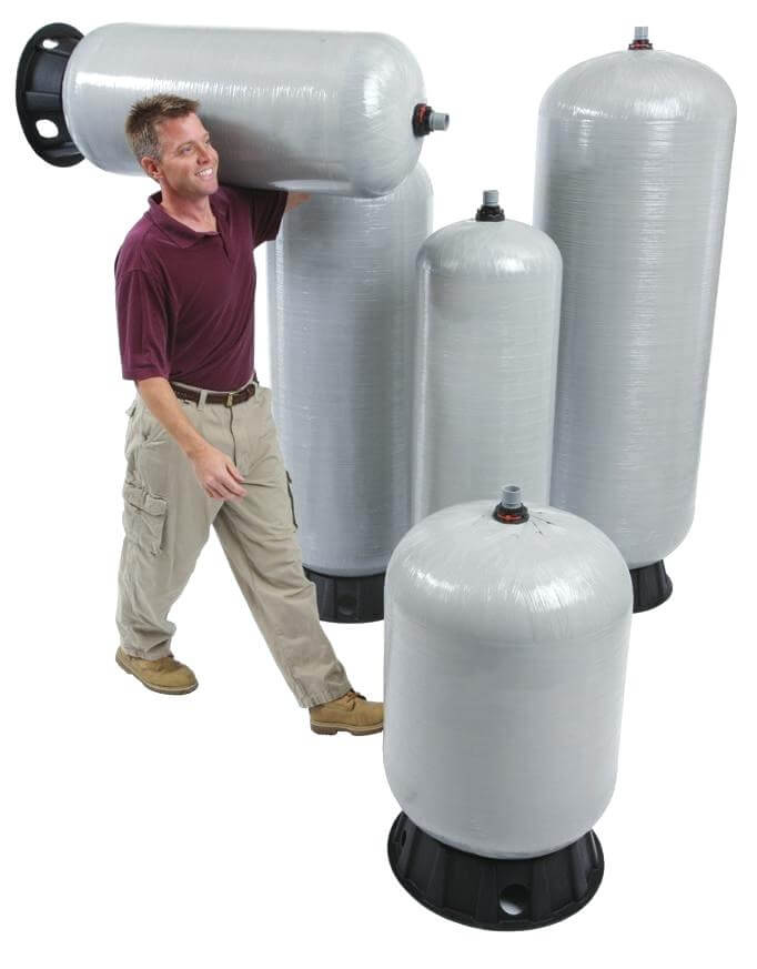 man carrying an amtrol pressure tank