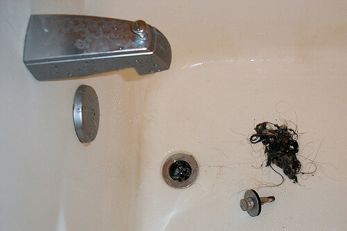 Plumbing problems: Bathtub drain with gobs of a gross hair clog removed