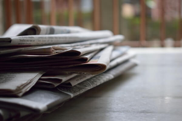 stacked newspaper