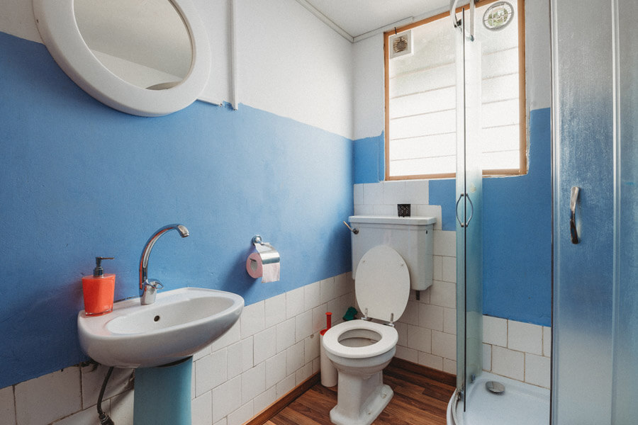 Bathroom having cleaned toilet bowl and sink