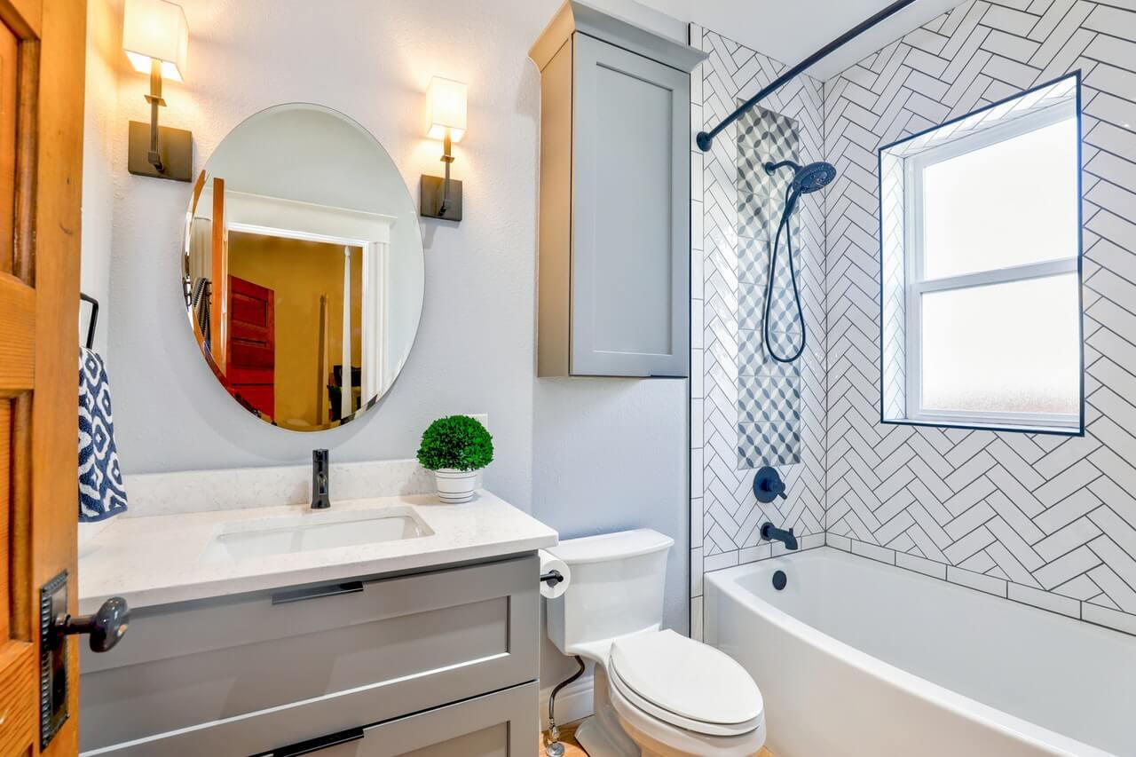 Photo of a bathroom with toilet near window